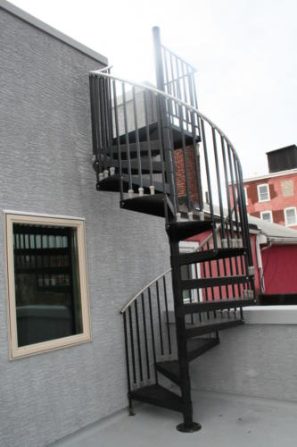 Spiral staircase to roof-top patio