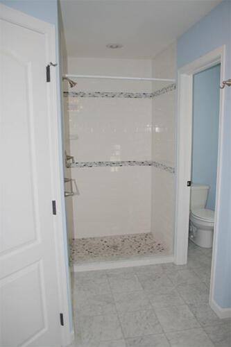 Full bathroom with a shower